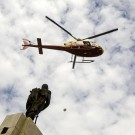 An helicopter throw first aid kits to the population near the Haitian National Palace following the recent earthquake. Photo Marco Dormino.