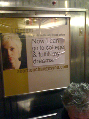 """An anti-abortion advertisement on a New York City subway from the organization Abortion Changes You has been defaced to now read: """"I thought life would be the way it was before. Now I can go to college & fulfill my dreams."""""""