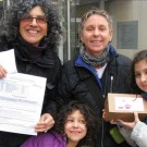 Julie Drizin and Ellen Kahn with daughters Jasper and Ruby celebrate receiving their marriage license