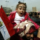 Image: A mother carries her daughter on her sho