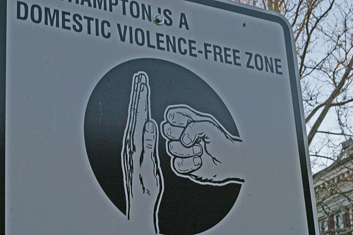 "ID: sign that reads ""northampton is a domestic violence-free zone"" in northampton, massachusetts"