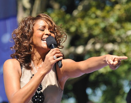ID: a picture of whitney houston singing