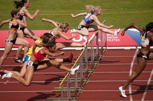 ID: image of a women's hurdles race event. ESPN is celebrating 40 years of Title IX