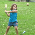girl swinging bat