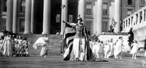 "German actress Hedwig Reicher wears costume of ""Columbia""  in front of the Treasury Building as part of suffrage march pageant. Allegorically, Columbia summoned Justice, Charity, Liberty, Peace and Hope to review the new crusade of women."