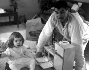 Father and daughter with Easy Bake oven, 1963