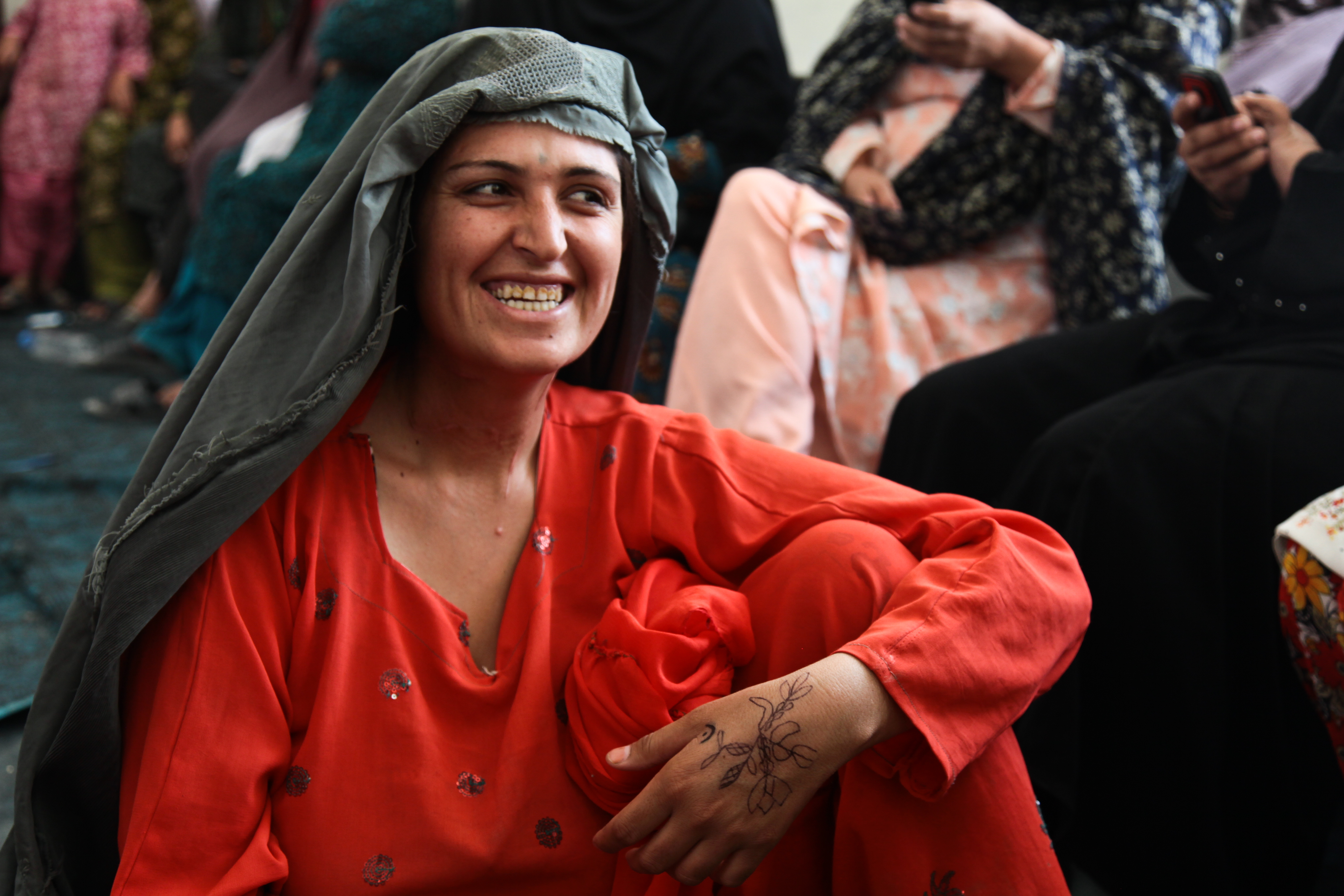 Afghan woman smiling in gathering