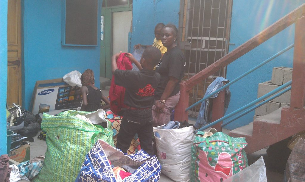 bimbo-and-others-selecting-relief-items-for-badia-east-children-courtesy