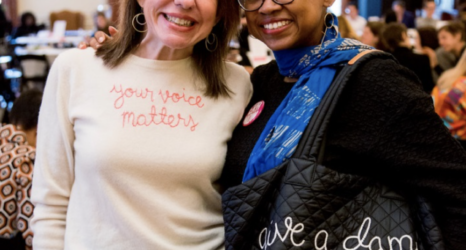 """Jennifer Weiss-Wolf and Jamia Wilson. Jennifer's Lingua Franca sweater reads """"your voice matters."""" Jamia's tote reads """"give a damn."""""""