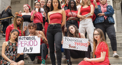 organization members at a menstrual equity protest in front of