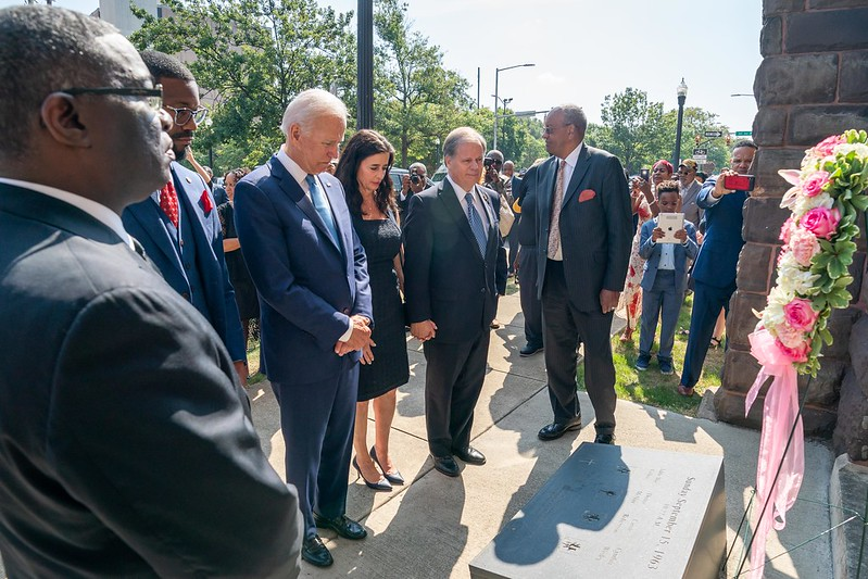 Biden stands with a group at the 16th Street Baptist Church in Birmingham, Ala., commemorating the life of four victims of a 1963 bombing. Biden, a staunch Catholic, is at the middle of a controversy with America's Roman Catholic bishops who have decided to deny Biden communion for his stance on abortion.