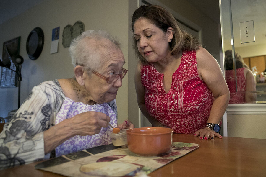 Mary Ellen Tolentino (right) helps her mother with Alzheimer's in Austin, Texas, on June 26, 2019.