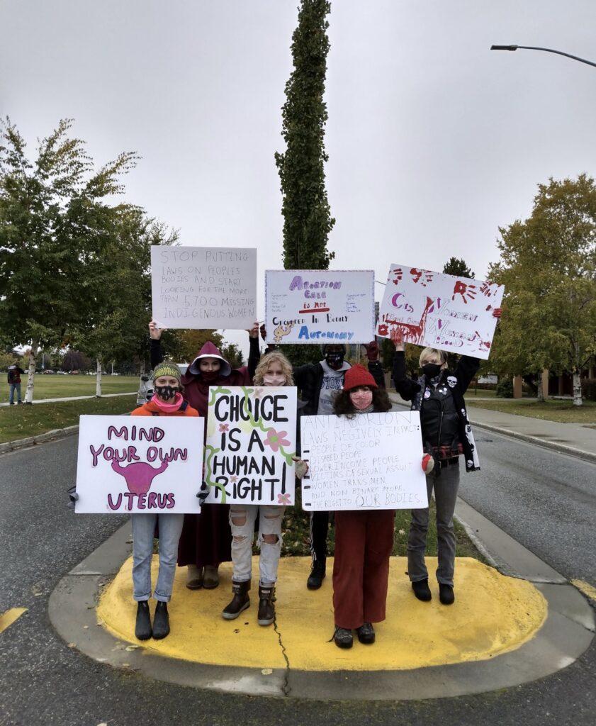 signs-womens-march-texas-abortion-ban-roe-v-wade-reproductive-rights